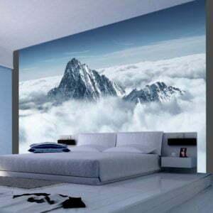 Fototapete - Bergspitze in den Wolken
